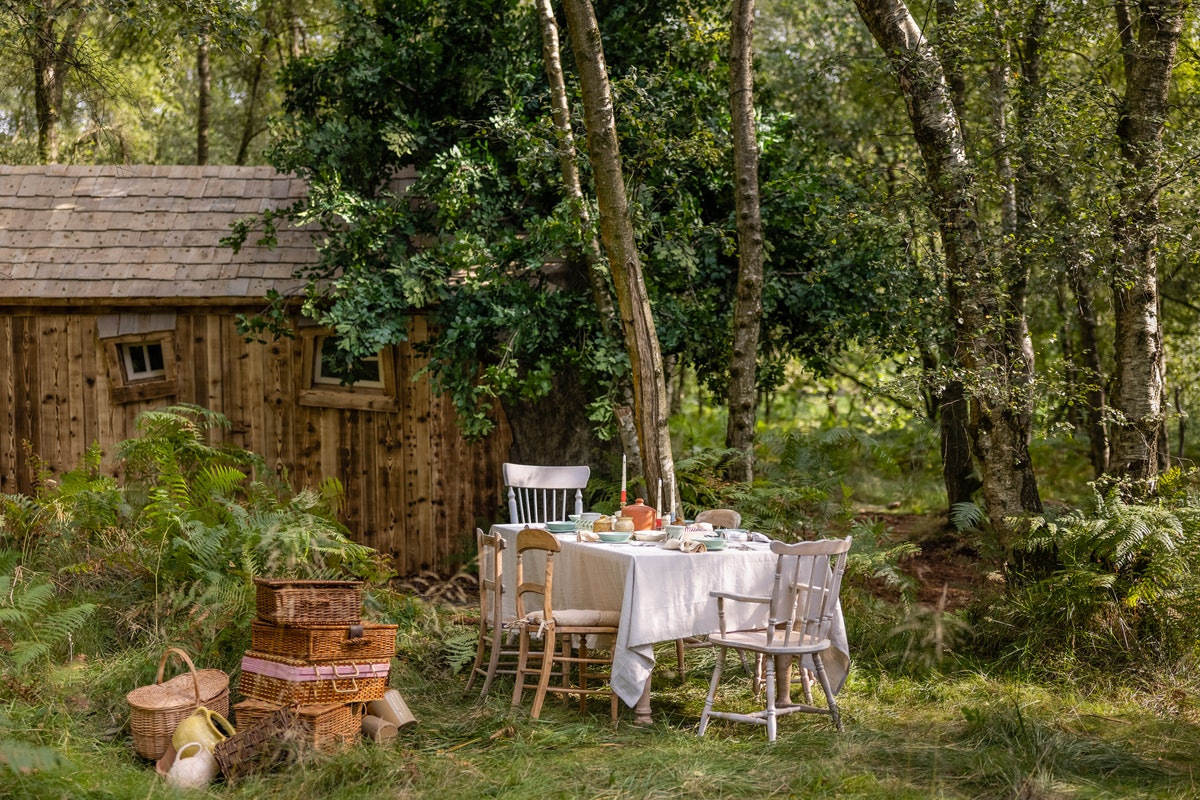 The outdoor dining table at Disney's 'Winnie the Pooh' Airbnb treehouse is very cottagecore.