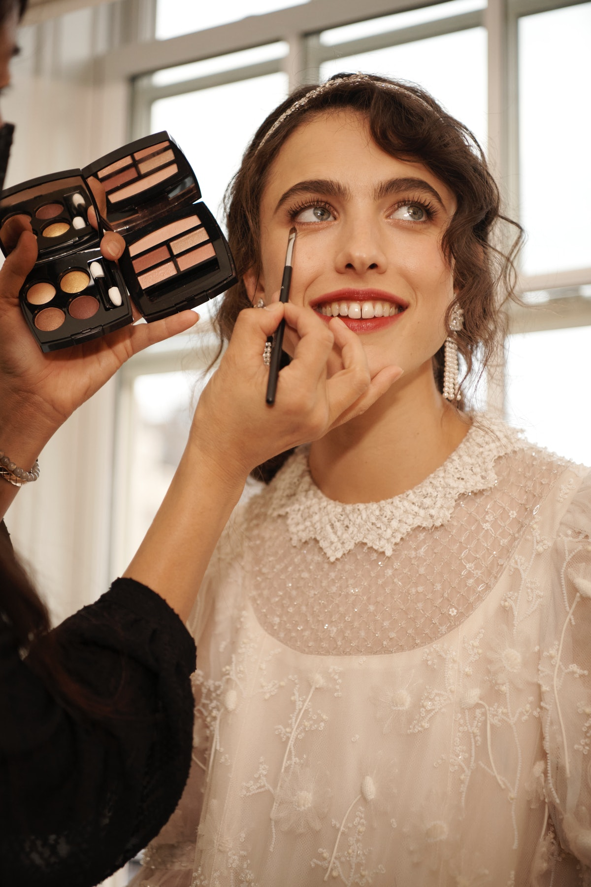 Margaret Qualley getting ready for the 2021 Met Gala