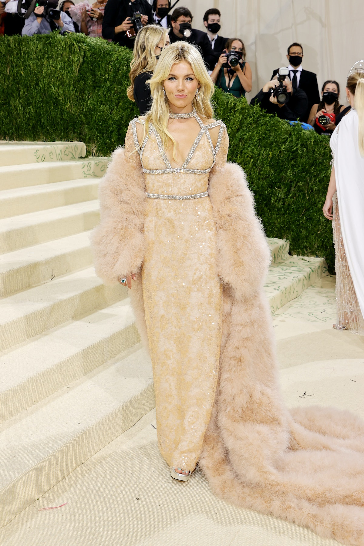 Sienna Miller attends The 2021 Met Gala Celebrating In America: A Lexicon Of Fashion at Metropolitan...