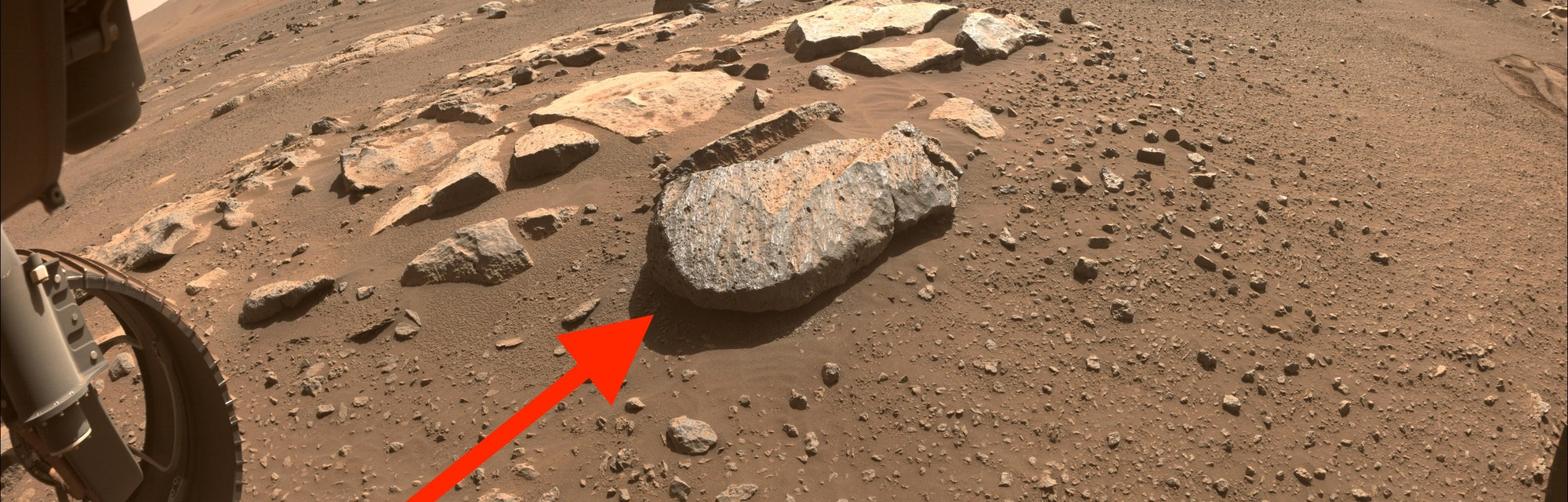 Near center of this image captured by the Perseverance rover on Mars is a large rock nicknamed Roche...