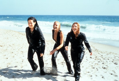 Cameron Diaz, Drew Barrymore and Lucy Liu walking on a beach in a scene from the film 'Charlie's Ang...