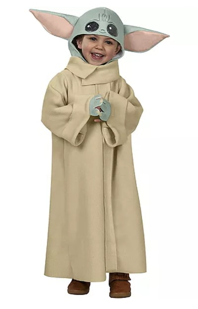 Toddler dressed up in Baby Yoda costume
