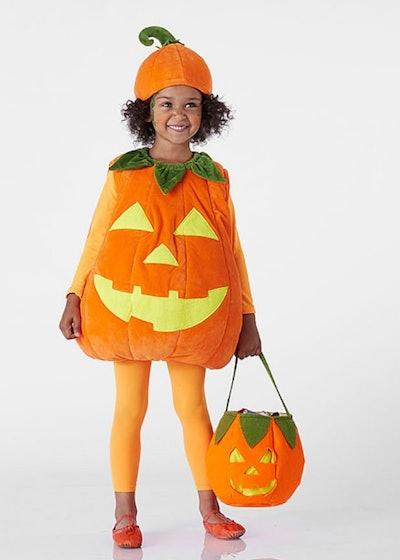 Little girl posing in Jack-o-lantern costume