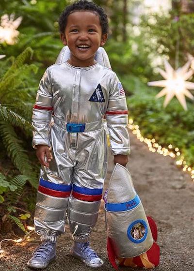 Little boy posing in astronaut costume