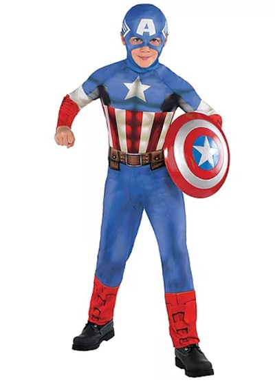 Boy standing, posing in Captain America costume