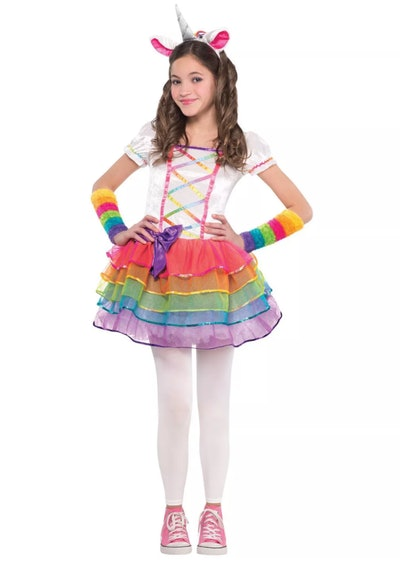 Little girl posing in unicorn tutu costume