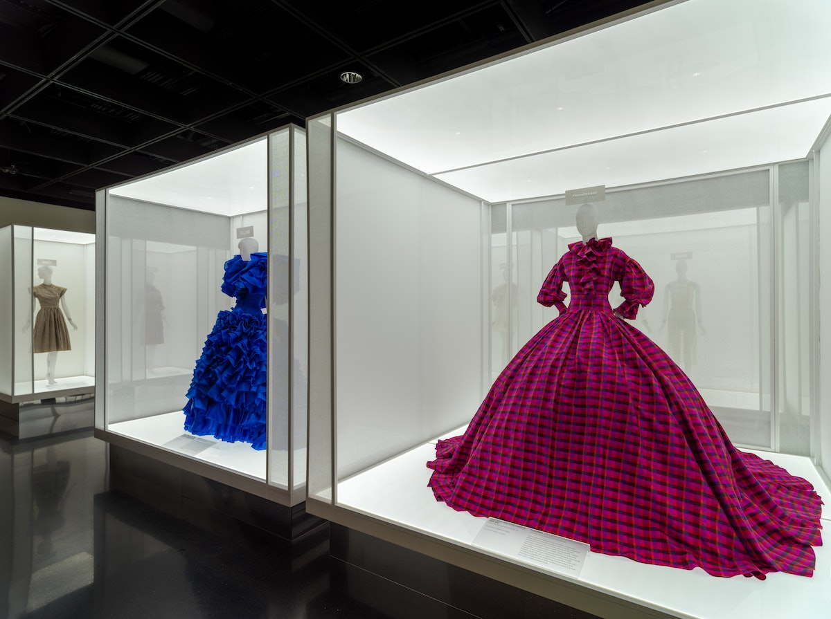 Gowns by Rodarte and Christopher John Rogers on display at the Metropolitan Museum of Art.