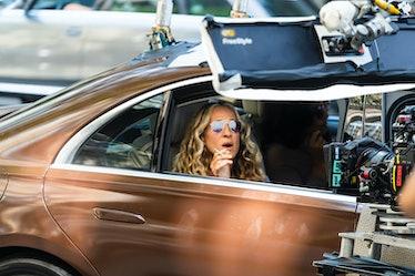 Sarah Jessica Parker, as Carrie Bradshaw, smoking