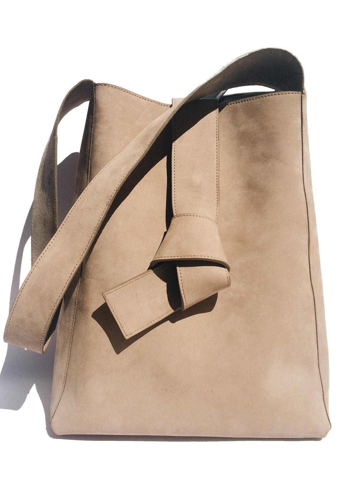 Beige Geneva bag from Thalia Strates, available to shop on The Folklore.
