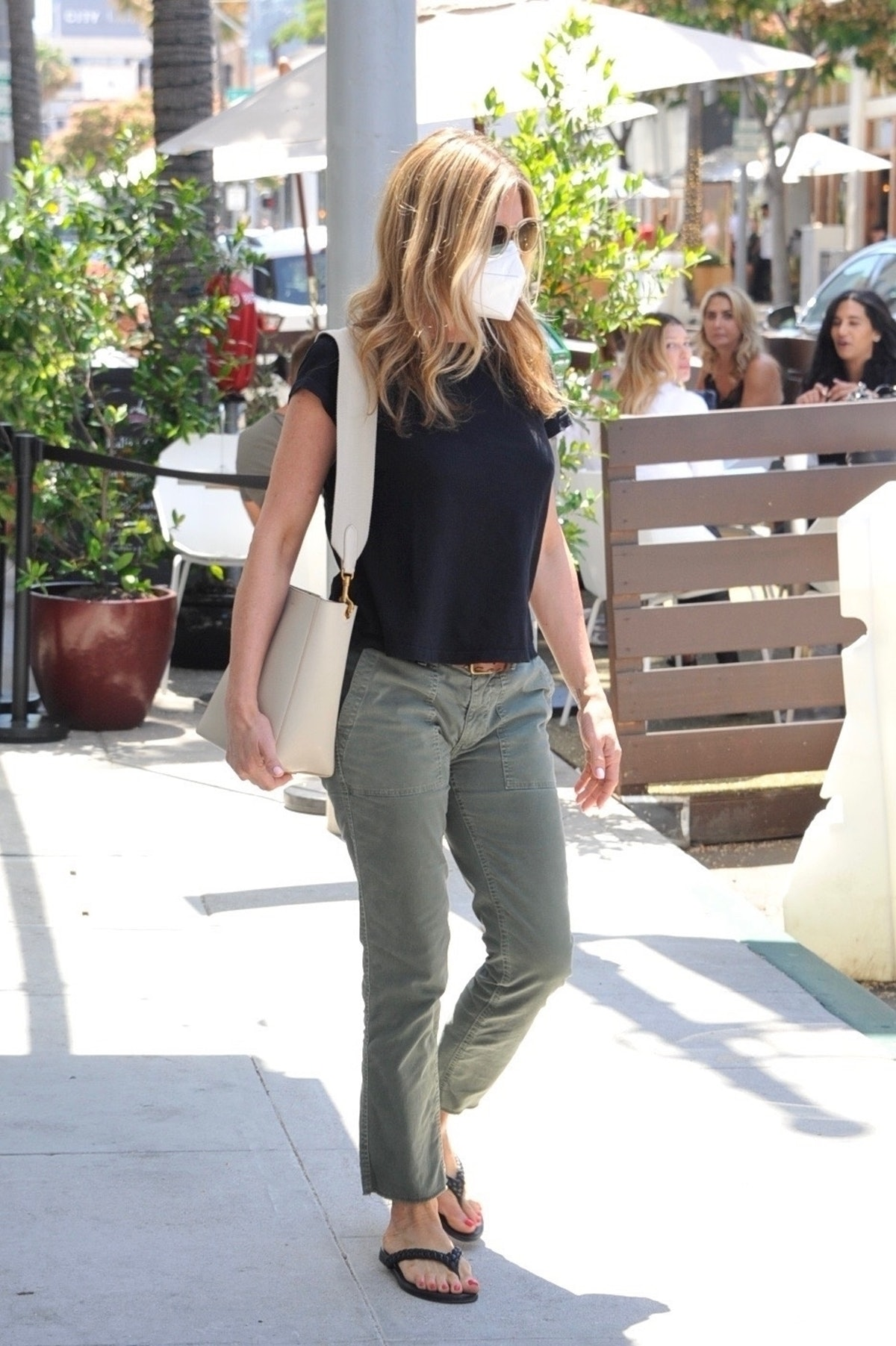 Jennifer Aniston wears white Celine small Sangle bag for her skincare appointment in Los Angeles on ...
