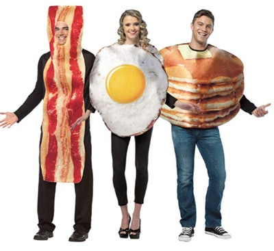 adults wearing bacon, eggs, and pancakes costumes