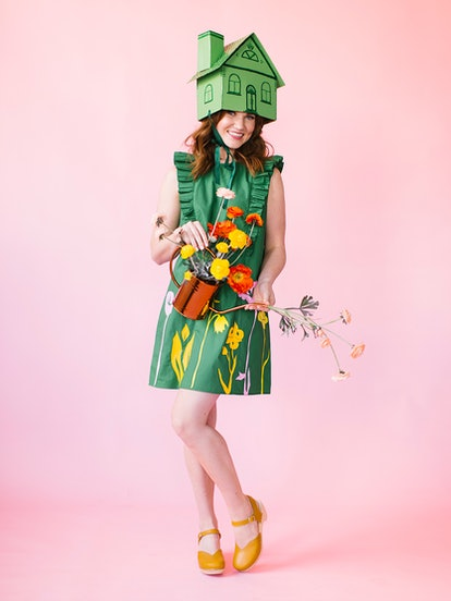 """""""Greenhouse"""" Halloween costume featuring a woman in a green dress with flowers and a cardboard house..."""