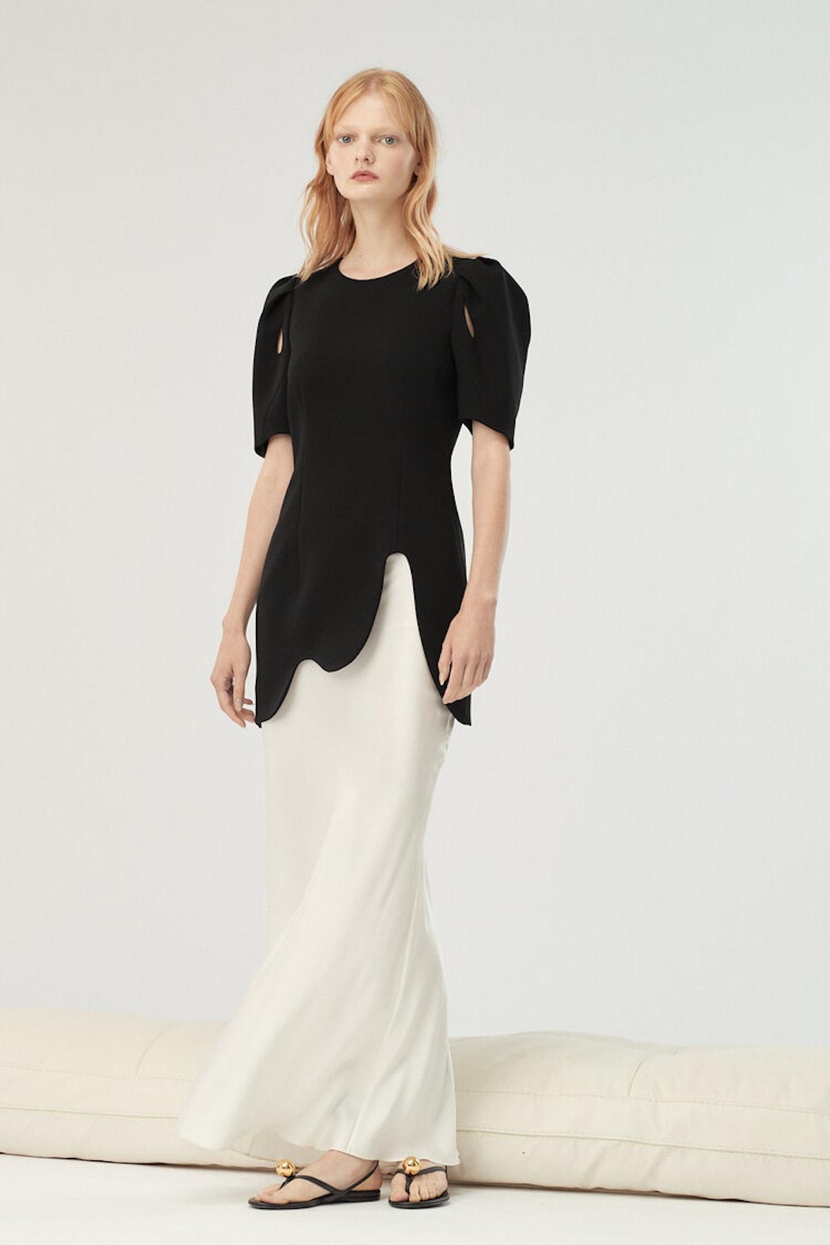 model in black shirt and white skirt