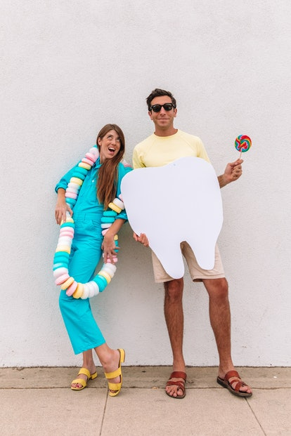 Sweet tooth punny halloween costume featuring a tooth and someone dressed up as a candy necklace