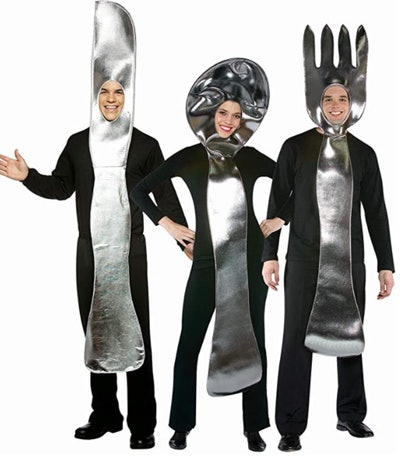 Three adults dressed as a fork, knife, and spoon