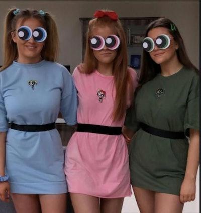 Three girls dressed as Powerpuff Girls
