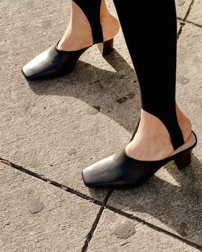 Stirrup leggings heeled mules.