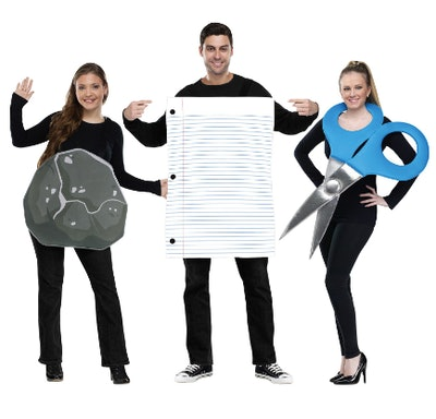 Three adults dressed as rock, paper, and scissors