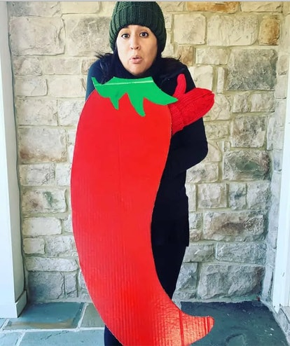 """DIY """"chilly"""" pepper costume feature a cardboard chili and a woman in warm clothes, hat, and gloves"""