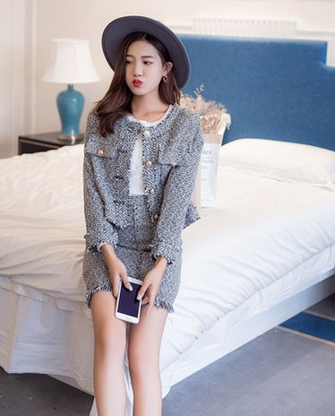 Monet De Haan on 'Gossip Girl' wears professional-leaning attire with fashion.