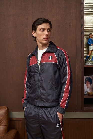 model wearing navy blue and maroon tracksuit