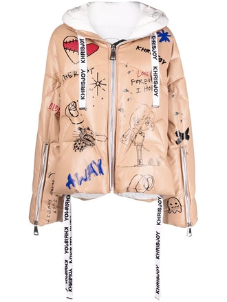 Graffiti-print oversize cropped leather puffer jacket from Khrisjoy, available to shop via Farfeth.