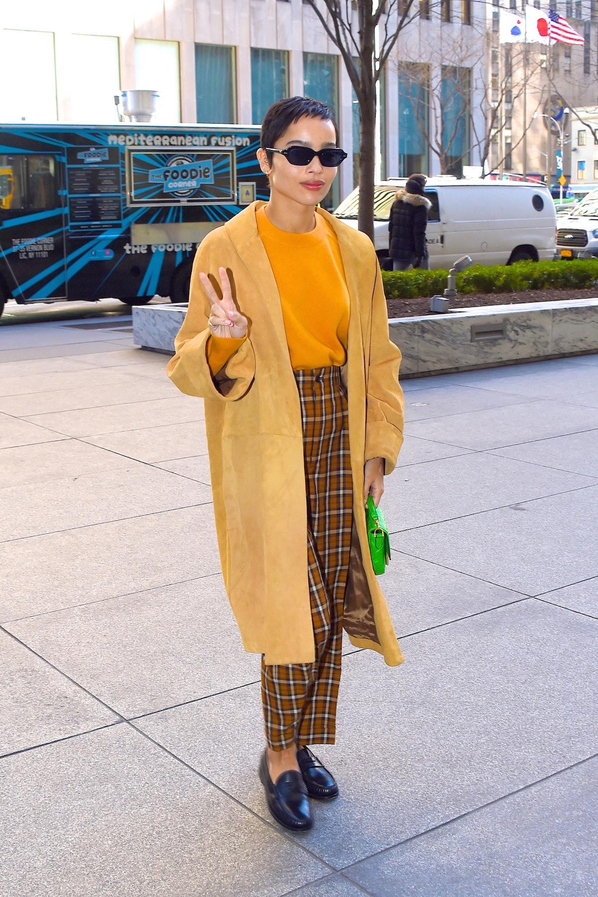 Zoe Kravitz in yellow coat.