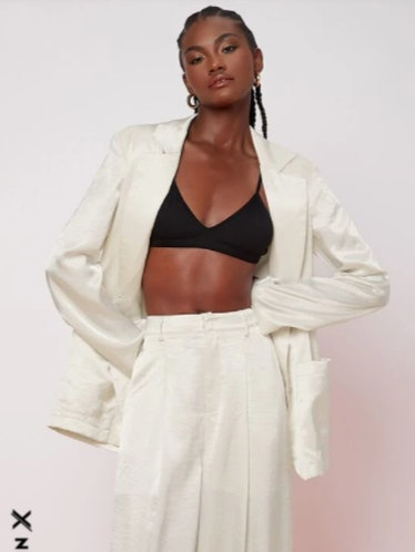 All-white blazer and pants set