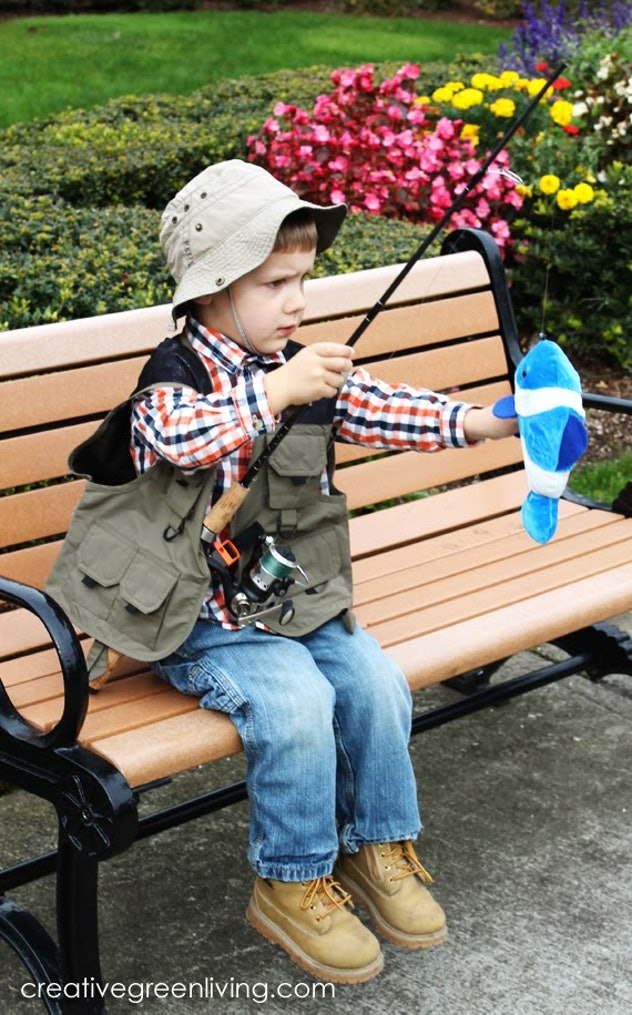 Little boy on a bench, dressed up as fisherman