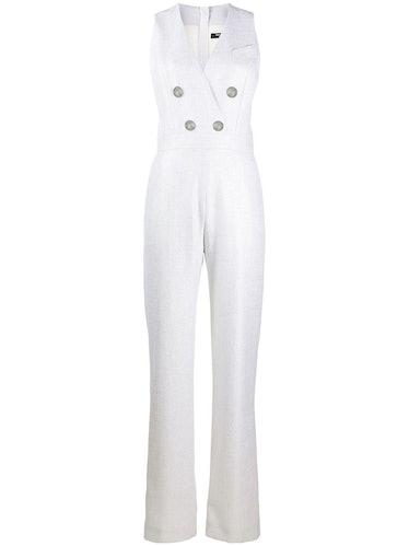Balmain's white double breasted sleeveless jumpsuit.