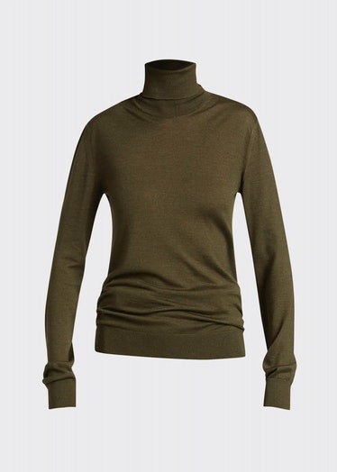 The Row's Demme cashmere olive green turtleneck sweater.