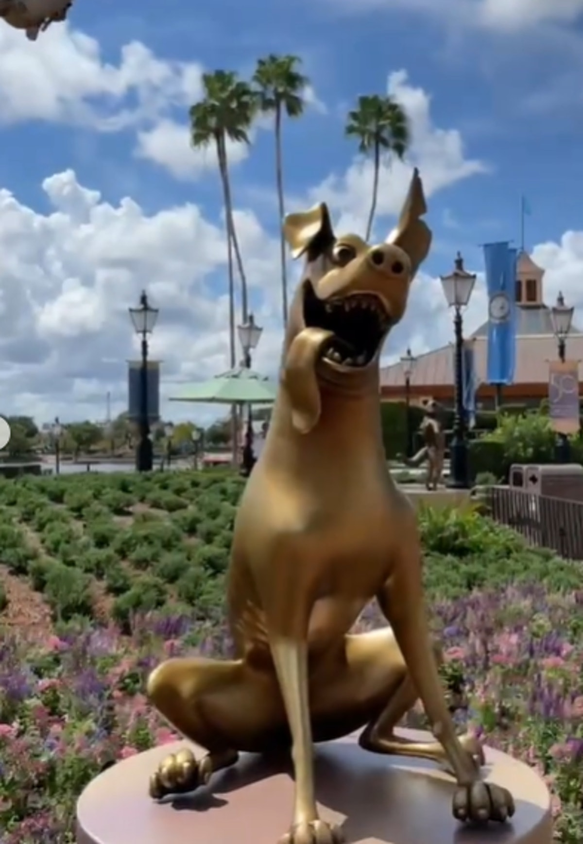 These pictures of Disney's 50th anniversary gold character statues are so cute.