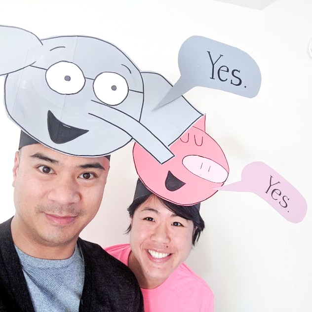 """Man and woman wearing headbands of """"Piggie and Elephant"""" characters"""
