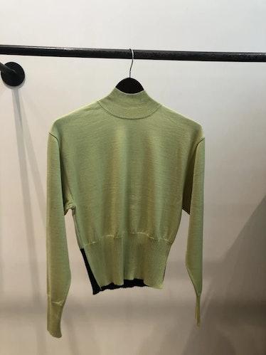 Akira Naka's color block turtleneck sweater.