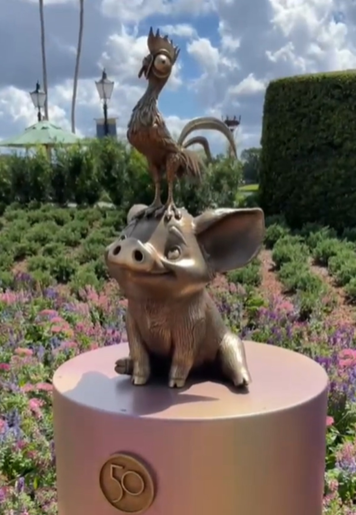 These photos of Disney's 50th anniversary gold character statues includes one of Pua from 'Moana.'
