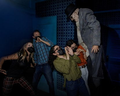 Guests get scared in 'The Haunting of Hill House' haunted house at Universal Studios' Halloween Horr...