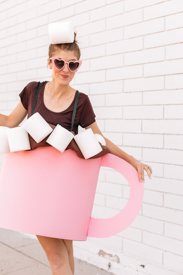 Woman wearing costume to look like a cup of hot cocoa