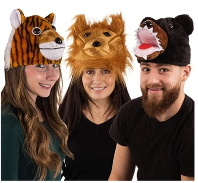 Three adults wearing lion, tiger, and bear hats