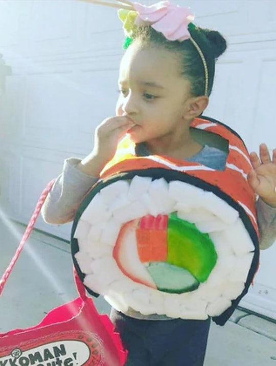 Little girl dressed up in costume to look like a sushi roll