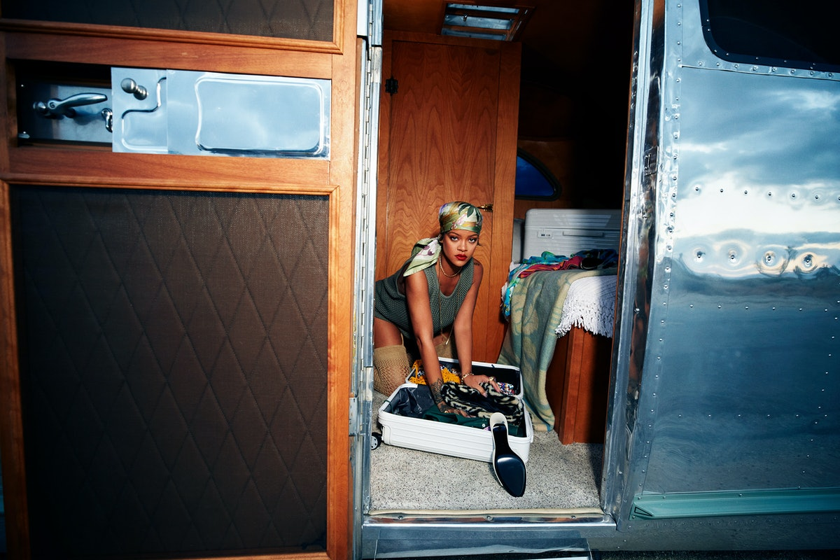 Rihanna packing a suitcase in a trailer