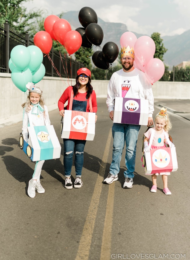 Mom, dad, and two girls dressed as characters from Mario Kart