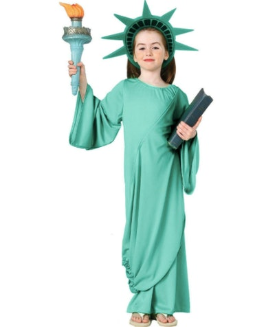 Girl dressed as the Statue of Liberty