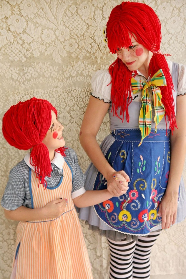 Mom and daughter, holding hands, dressed up as rag dolls