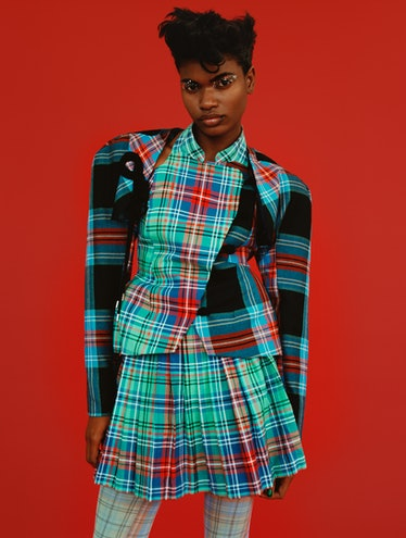 Briana Michelle  wears a Charles Jeffrey Loverboy jacket, skirt, and tights.