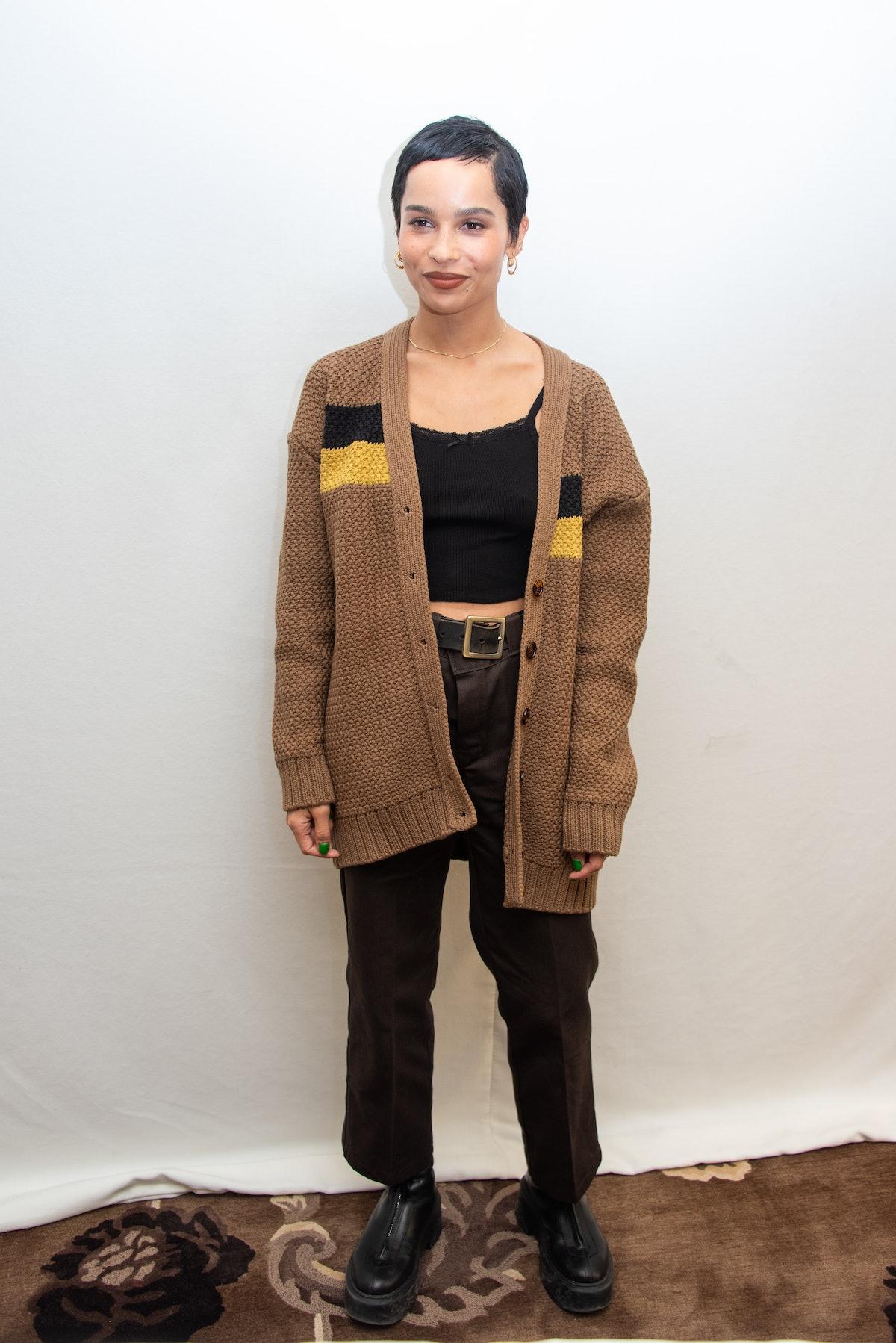 Zoe Kravitz in cardigan.