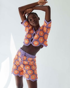 Model wears crochet top and shorts from Latina-owned clothing brand Tach Clothing.