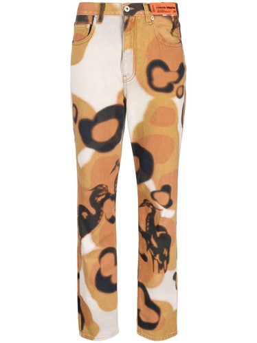 Camouflage printed slim jeans from Heron Preston, available to shop via Farfetch.