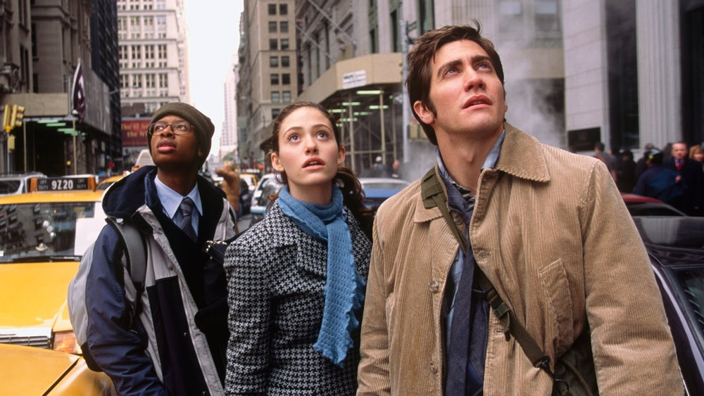Jake Gyllenhaal, Emmy Rossum, and Arjay smith in The Day After Tomorrow.