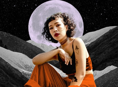 Young woman in front of a moon to show your October 2021 monthly horoscope.