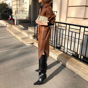 Embossed black leather boots by Totême.